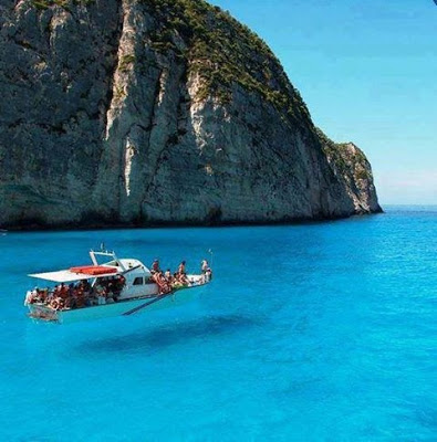 Zakynthos Island, Greece. The water is so clear, it looks like the boat is floating in the air.